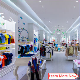 China Customized nice design fashion white wooden kids clothing store interior design,kids baby shop design decoration fábrica